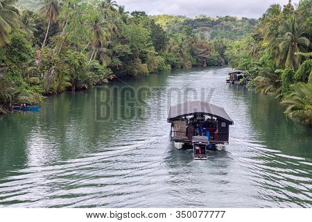 Bohol, Philippines - January, 27, 2020: Floating Buffet Restaurant Cruise On Loboc River