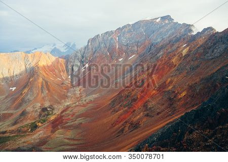 Vivid Multicolor Landscape To Big Rocky Mountain Ridge. Giant Highland Rough Wall Close-up. Red Oran