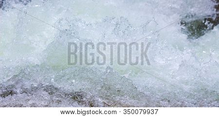 Texture Of Water With Foam In A Mountain River