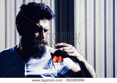 Man Relaxing And Enjoing. Portrait Of Self Confident Brutal Man Whiskey Drinker. Whisky, Brandy Or C