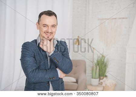 Handsome Happy Man Smile Standing At Home