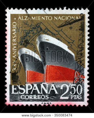 ZAGREB, CROATIA - SEPTEMBER 18, 2014: A stamp issued in Spain shows Shipbuilding, 25th Anniversary of National Uprising series, circa 1961.