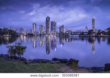 Surfers Paradise City Skyline On Dusk With Perfect Reflection On Water And Dramatic Sky Background,