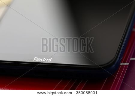 Barcelona, Spain - February 10, 2020: Xiaomi Redmi Logo At Modern Smartphone Screen Lying At Colorfu