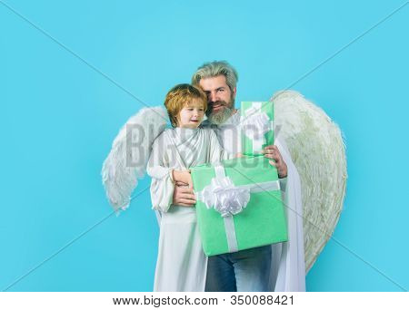 Father And Son Angels. Little Cupid Boy Gives Father Gift. Father's Day. Gift Box. Happy Father In A