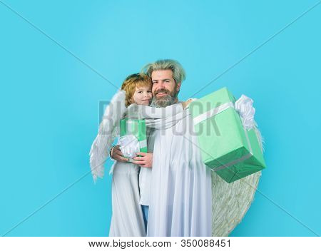 Father's Day. Father And Son Angels. Gift Box. Little Cupid Boy Gives Father Gift. Happy Father In A
