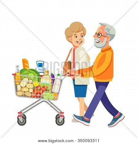 Happy Old People Shopping. Retired Couple With Shopping Trolley With Foods In The Supermarket. Elder