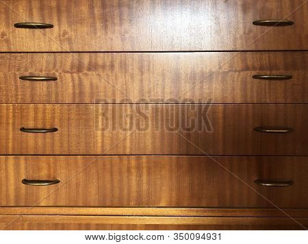 Wooden Dresser With Golden Metal Handles Close-up. Wooden Furniture