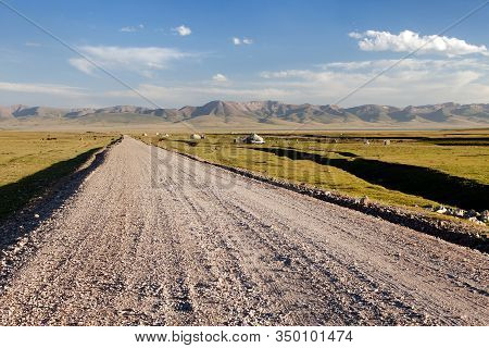 Unpaved Road And Yurts Near Son-kul Lake And Tian Shan Mountains In Kyrgyzstan