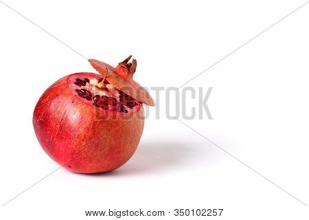 Ripe Pomegranate Fruit Isolated On White Background Cutout. Pomegranate Seeds. Pieces Of Pomegranate