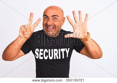 Middle age safeguard man wearing security uniform standing over isolated white background showing and pointing up with fingers number seven while smiling confident and happy.