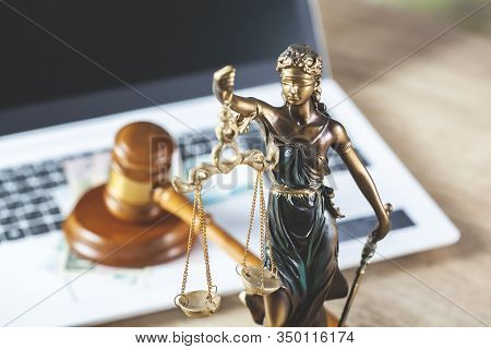 Judge And Justice Lady On Computer  On Table