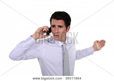Man talking with his wife on the phone