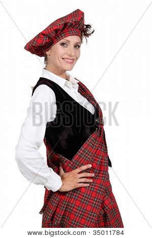 Woman in a traditional tartan outfit