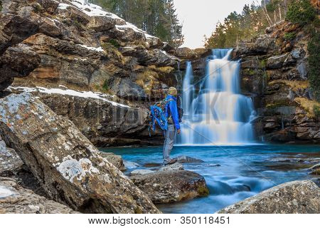 Mountaineer Boy In Front Of Waterfall With Silk Effect.freestyle Concept