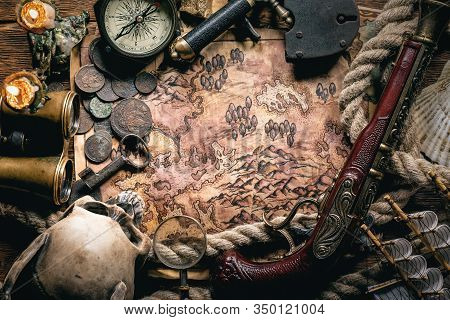 Pirate Treasure Map On Brown Wooden Table Flat Lay Background.
