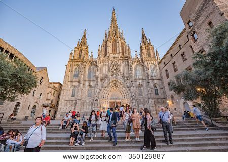 Barcelona, Spain - October, 2019: Walking Barcelona City Streets. View Of Exterior Facade Of Cathedr