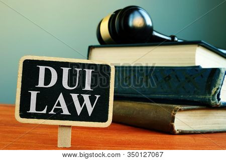 Dui Law Driving Under The Influence Sign And Book.