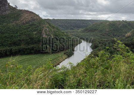 Nawiliwili, Kauai, Hawaii, Usa. - January 16, 2020: Gray South Fork Wailua River Meanders Between Gr