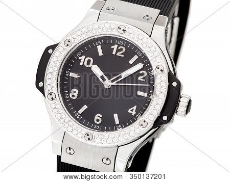 Wristwatch Decorated With Rhinestones Made Of Precious Stones On A Silver Case With A Black Dial And