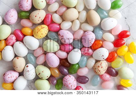 Happy Easter Concept. Preparation For Holiday. Easter Candy Chocolate Eggs And Jellybean Sweets On T