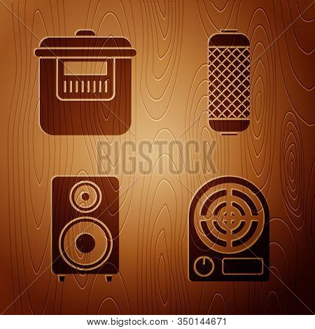 Set Electric Heater , Slow Cooker , Stereo Speaker And Stereo Speaker On Wooden Background. Vector
