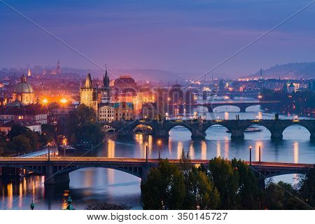 Elevated View To The Bridges Crossing Vltava River In Prague During Beautiful Sunset