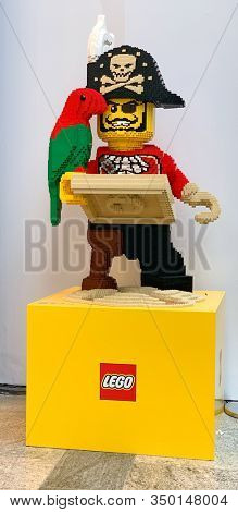 Southampton, UK - 8 November 2019: Large Lego model of a pirate captain, with treasure map, hook hand, peg leg and parrot, outside the newly opened Lego Store in West Quay shopping mall, Southampton.