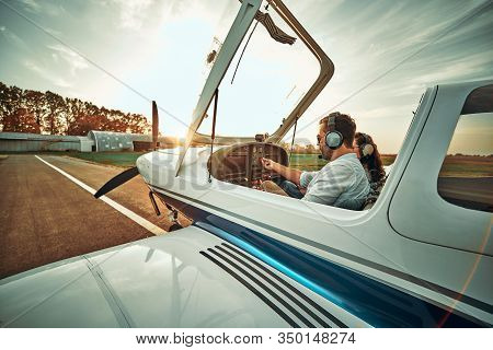 Pilot With Co-pilot Prepare Take Off In A Small Aircraft