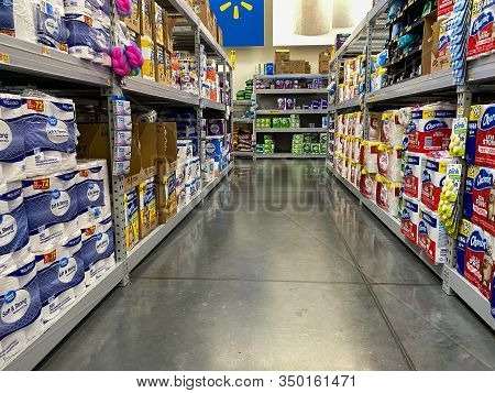 Orlando,fl/usa -2/6/20:  The Toilet Paper Aisle Of A Walmart Superstore With A Variety Of Products F