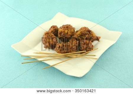 Boneless Chicken Nuggets With Barbeque Sauce Appetizer On Plate With Long Toothpicks