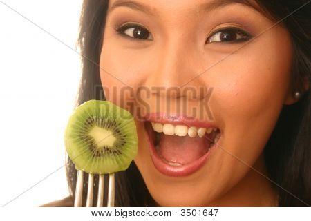 Woman Eating Kiwi