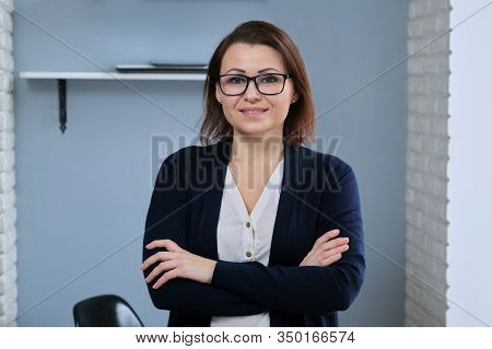 Portrait Of Positive Confident Mature Woman With Folded Arms, Female Doctor, Psychiatrist, Psycholog