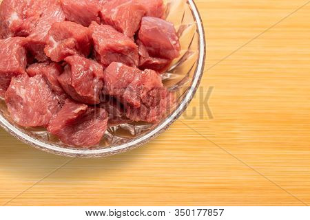 Fresh Raw Diced Beef Meat In A Glass Plate On Cutting Board
