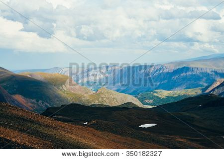 Different Climate In One Vast Mountain Landscape At Different Heights And Distances. Aerial Alpine L