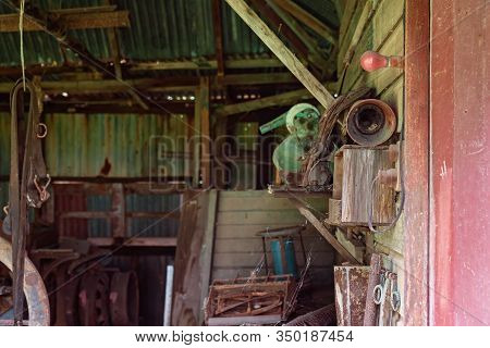 Old Rusted Farm Tools From Yesteryear In An Abandoned Country Shed