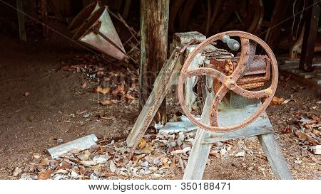 An Old Rusted Chaff Cutter Which Would Have Been Used For Chopping Hay To Feed Animals By Early Sett