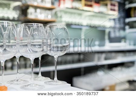 Shelves Of Modern Stemware Glasses For Sale In Store.glasses And Stemware Set. Designer Glassware On