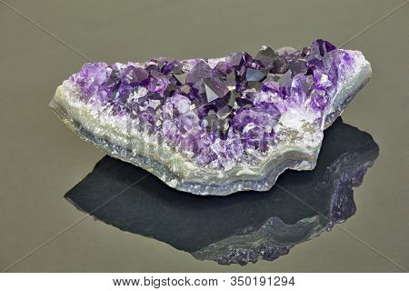 macro photo of lilac amethyst druse on dark background