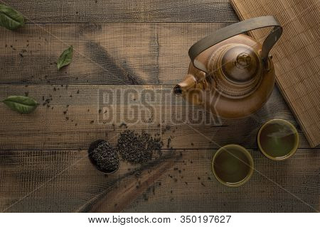 Tea Concept. Teapot With Tea On Table. View From Above With Copy Space. Asian Tea Bowl And Teapot.