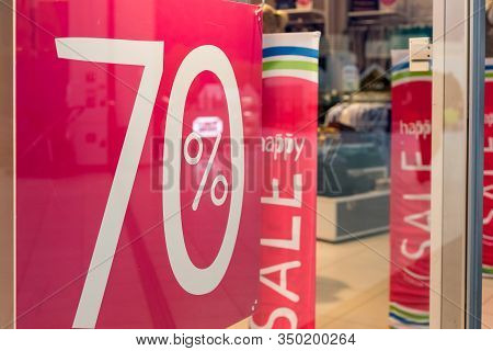 Sale Sign 70 Percent In A Fashion Clothes Shop Display Window.sale Banner Promotion Offer Percent Di