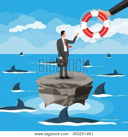 Businessman On Tiny Island In Sea Surrounded By Sharks Getting Lifebuoy. Helping Business To Survive