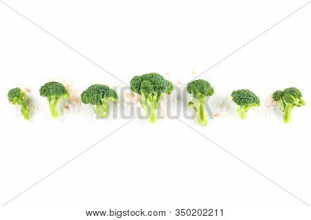 Broccoli Florets, Shot From The Top On A White Background With Natural Salt And Copy Space