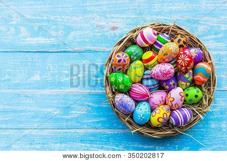 Easter Holiday Concept,colorful Easter Eggs In Basket On Blue Pastel Color Rustic Wood Background Wi