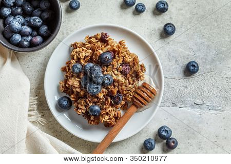 Baked Oatmeal With Blueberries And Honey In On A White Plate. Oatmeal Fruit Crumble Pie, Copy Space.