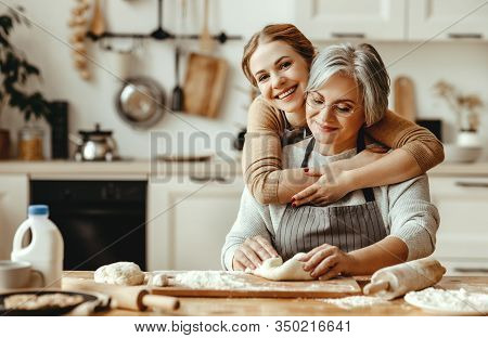 Happy Family Grandmother  Old Mother Mother-in-law And Daughter-in-law Daughter Cook In Kitchen, Kne