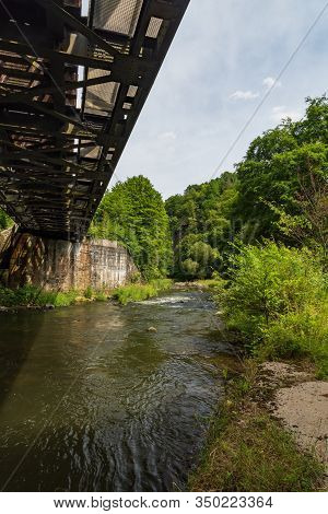 Weisse Elster River With Railway Bridge Above And Trees Around Between Plauen And Elsterberg Towns I