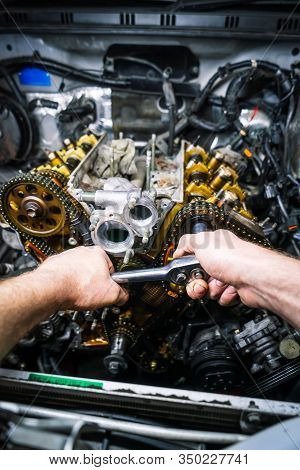 Car Repair: Overhaul Of The V6 Engine With Detailed Pulleys And Parts.