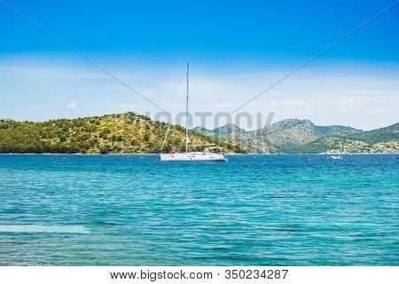 Croatia, Adriatic Coast, Beautiful Seascape On Dugi Otok Island, Yachts Anchored In Blue Bays In Tel