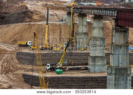Construction Or Reconstruction Of Highway Concrete Bridge Over A Wide River. Construction Machinery,